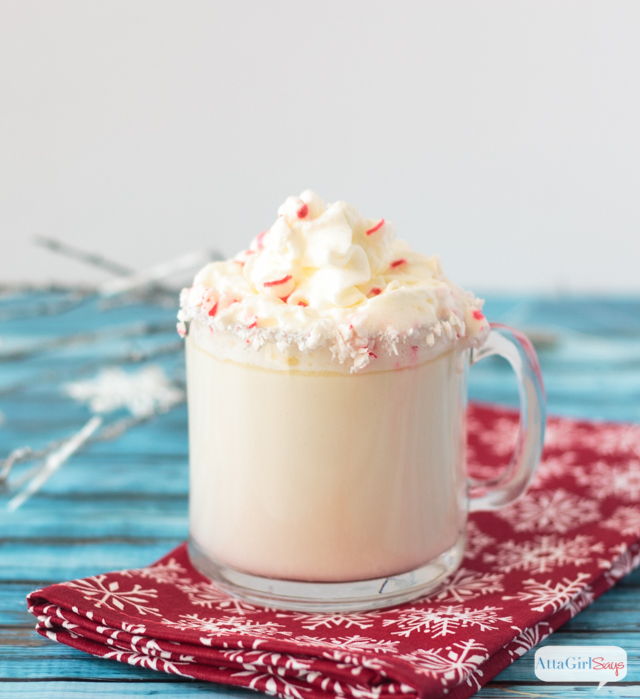 Peppermint Twist White Hot Chocolate in a glass mug on a red snowflake napkin