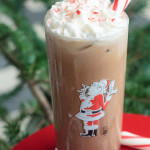 santa glass filled with iced peppermint mocha