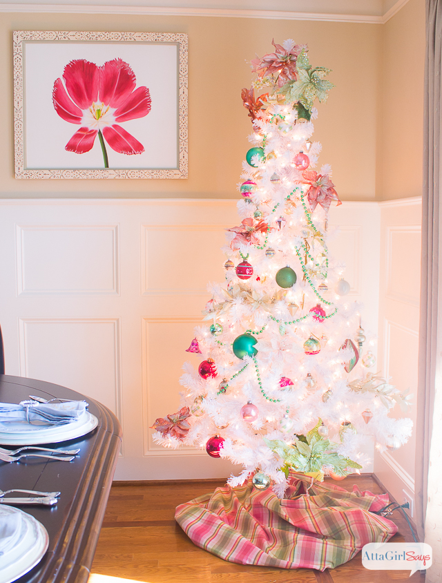 I love the vintage, preppy look of this white Christmas tree. It's decorated with vintage Shiny-Brite ornaments in pink, green, white, silver and gold. A great use of nontraditional colors for Christmas.