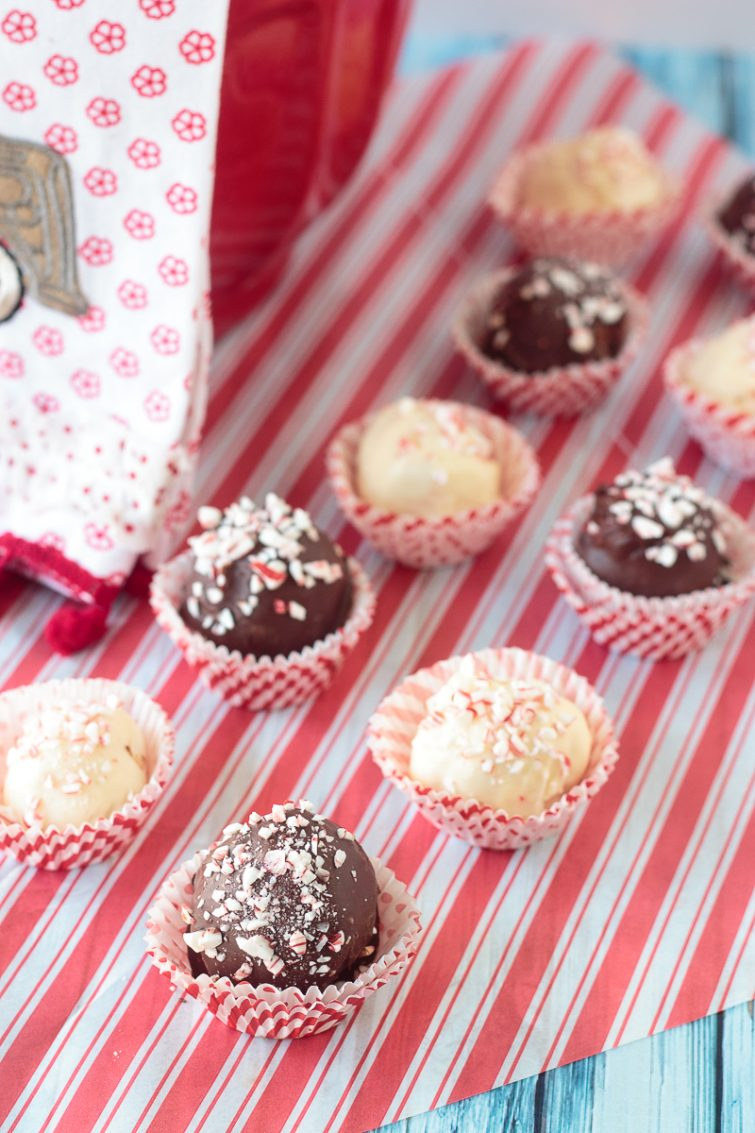 white and dark chocolate peppermint candies on red and white parchment paper