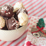 white and dark chocolate candies covered with peppermint in a bowl