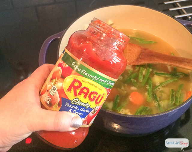 adding tomato sauce to minestrone soup