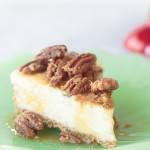 slice of pecan pie cheesecake on a green plate