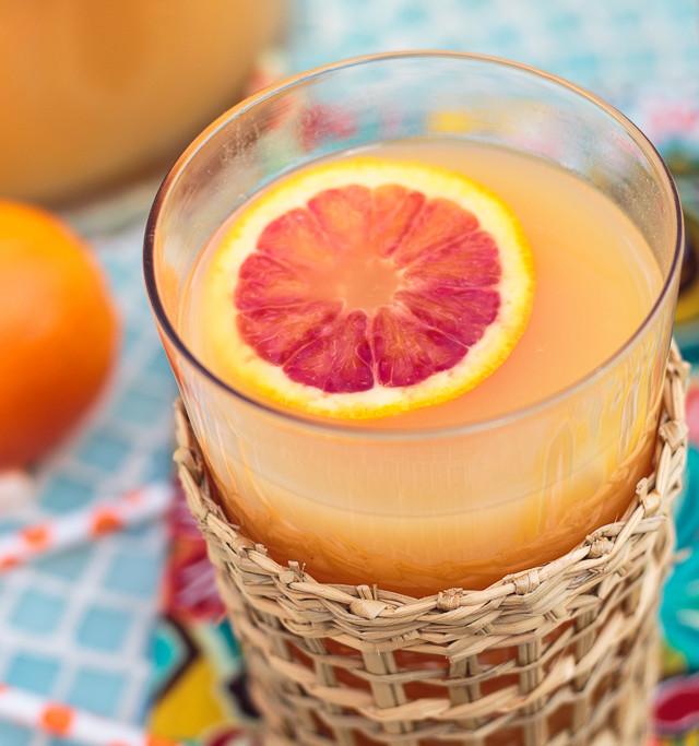Hawaiian POG juice with a blood orange slice in a glass