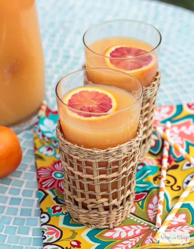 two glasses of Hawaiian POG juice on a tropical napkin