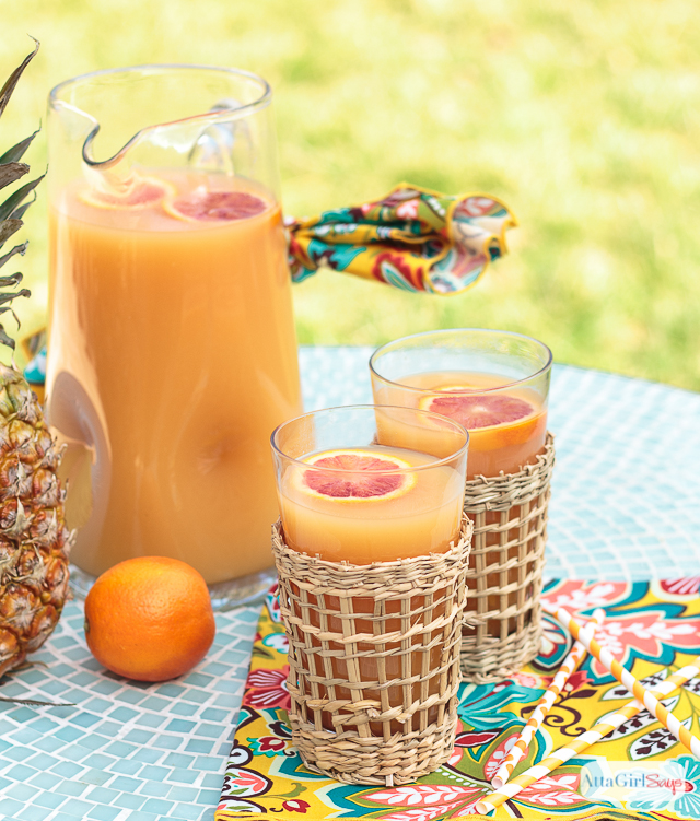 2 glasses and a pitcher of Hawaiian POG juice