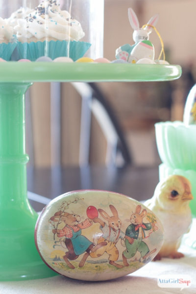 jadeite cake stand and paper easter egg on a dining room table