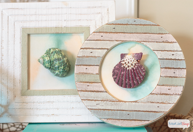Create your own custom artwork using rustic frames and seashells. If you love coastal decor, you'll love this gorgeous guest bedroom makeover.