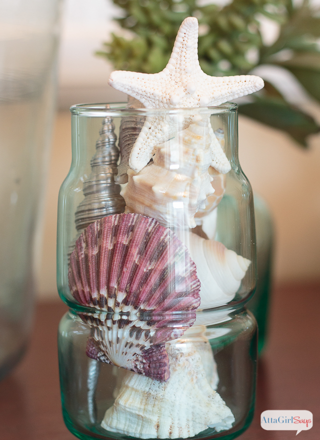 Showcase some shells in an inexpensive glass vase to add some coastal decor to your home.