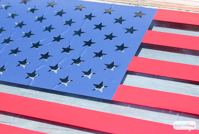 Use red and blue vinyl, cut with a Silhouette Cameo or Cricut Explore, to make American flag art from an old window. #CelebrationsofHome