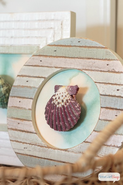 framed seashell on a watercolor background