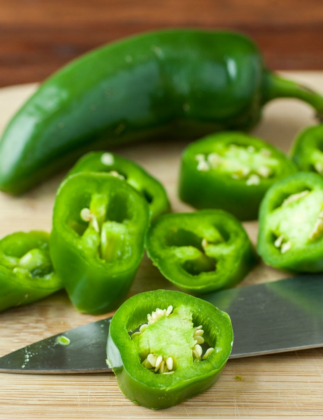 Use sliced fresh jalapenos peppers to make a fiery infused bourbon to use in boozy homemade limeade and other summertime cocktails. #sponsored #FoodShouldTasteGood