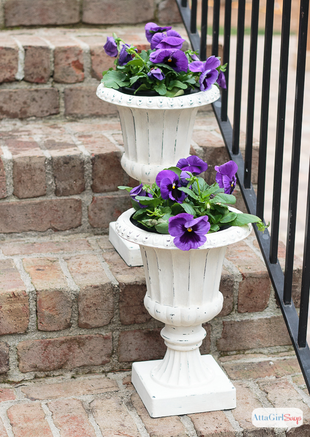 Use paint to give plastic urns new life. See how I used Chalky Finish paint to make these look like stone planters.