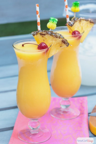 spiked frozen lemonade with pineapple infused rum in hurricane glasses