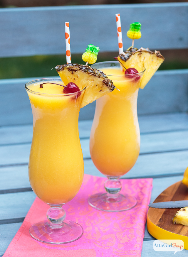 frozen tropical lemonade in hurricane glasses
