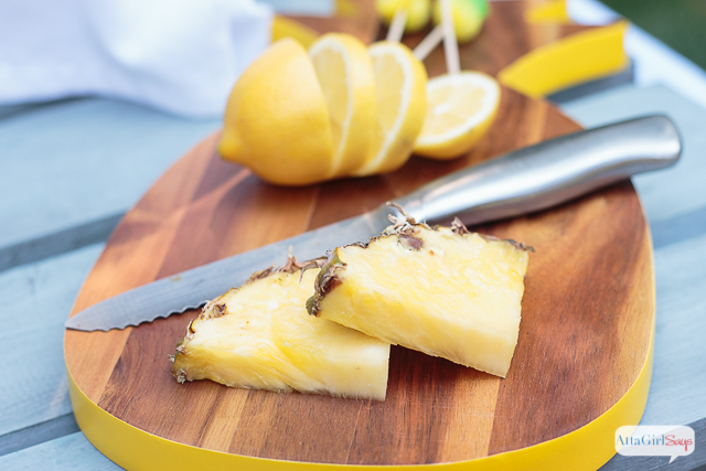 pineapple slices on a pineapple shaped cutting board
