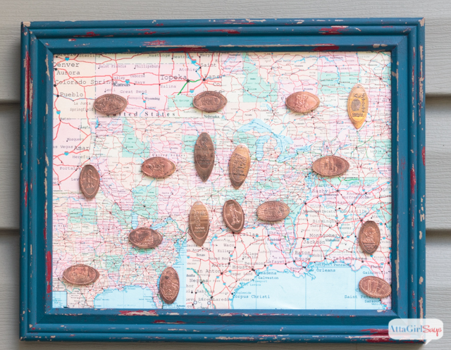 framed map with pressed pennies marking places you've visited