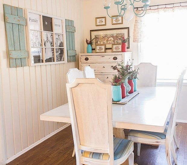 kitchen with laminate floors and painted dining table