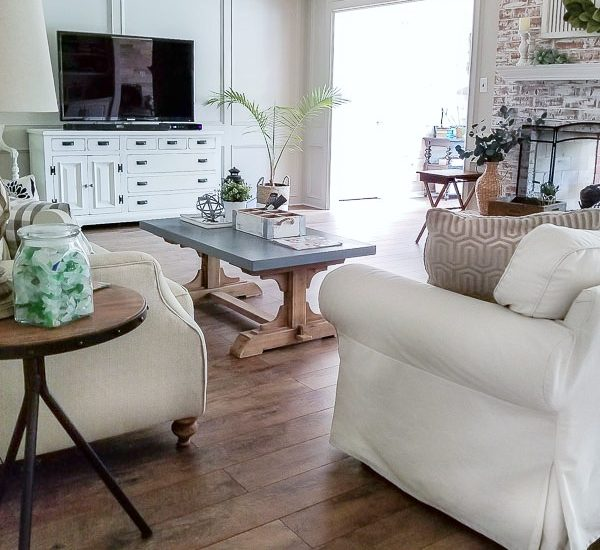 living room with farmhouse style handscraped laminate floors