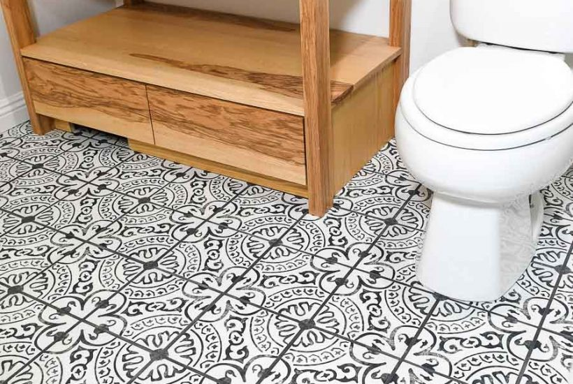 encaustic style black and white patterned porcelain tile floors in a bathroom
