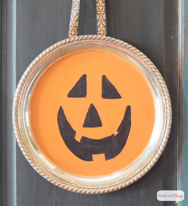 jack-o-lantern painted on a silver tray