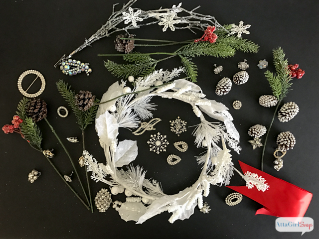 Bring a little sparkle and shine (and lots of glitter!) to your Christmas decorating by making a jeweled Christmas wreath using vintage rhinestone jewelry.