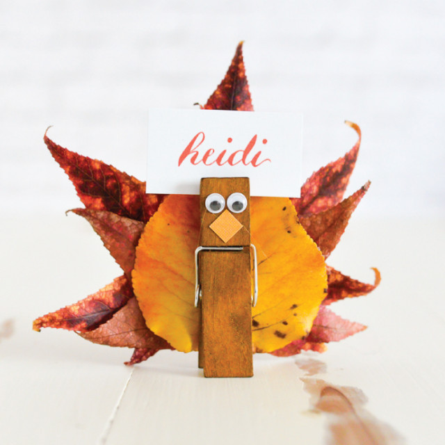 This place card holder is just one of the adorable Thanksgiving turkey crafts you can make with leaves. Click to find links and instructions for them all.