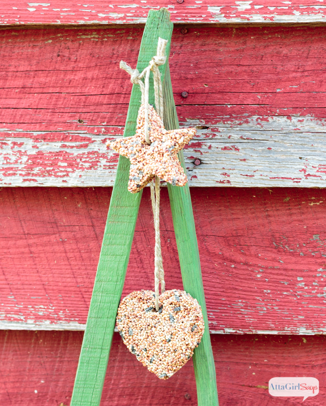 Keep the birds happy and well fed all winter long by making aTobacco Stick Christmas Tree that doubles as a feeder. Construct a simple frame out of tobacco sticks, paint it and then hang homemade birdseed ornaments from hooks. #sponsored #decoartprojects