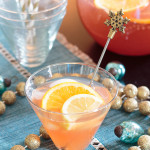 glass of holiday spiked punch with orange slices
