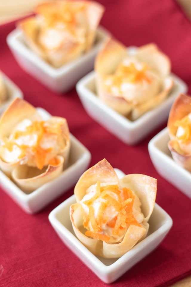 cream cheese pepper jelly wonton cups garnished with shredded carrots