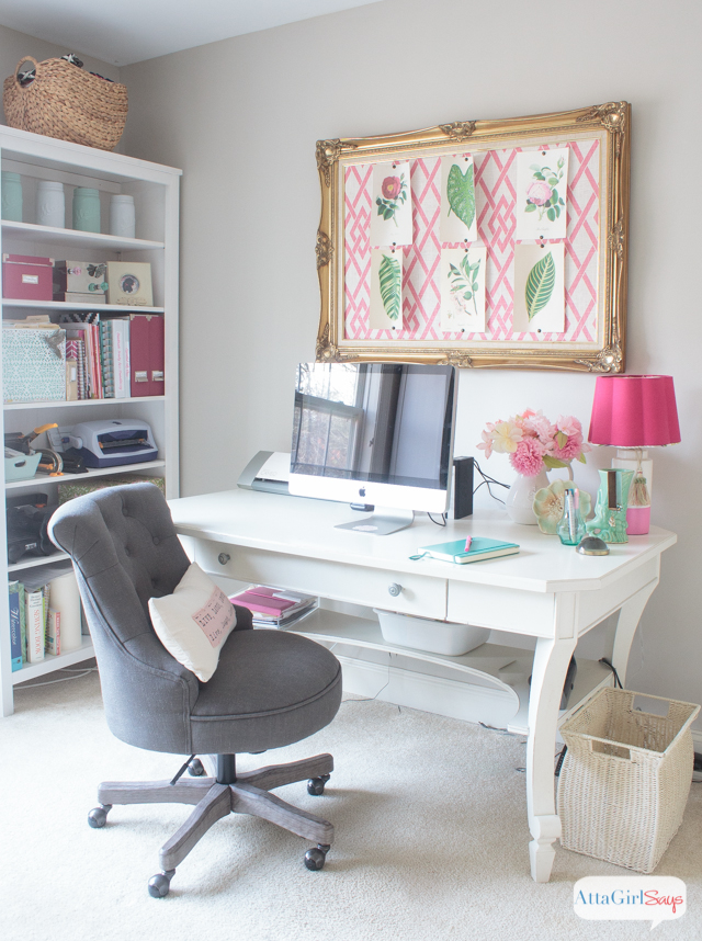 gray chair at a white desk in a feminine home office