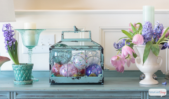 Your entryway or foyer is the first impression guests will have of your home. It's a great way to let your decorating personality shine. I'm in love with this show stopping pink and aqua rug, the painted buffet, the vintage pottery and everything about this foyer. What does your foyer decor say about your style? #sponsored