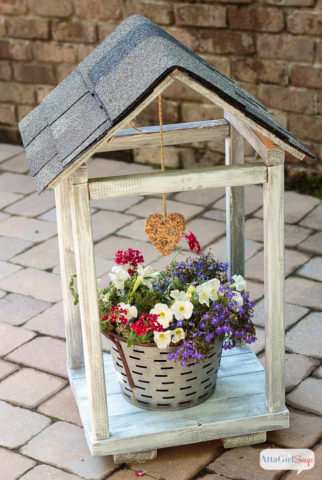 Learn how to build (and shingle the roof) of a DIY bird feeder plant atrium, using inexpensive, salvaged materials. This is a great project to do with kids. #ad #RoofedItMyself