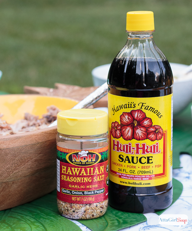 Hawaiian seasoning salt and Huli-Huli sauce beside a bowl of Kalua pork