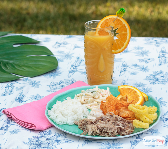 Hawaiian luau food - kalua pork, macaroni salad, Hawaiian potato chips, rice and pog juice