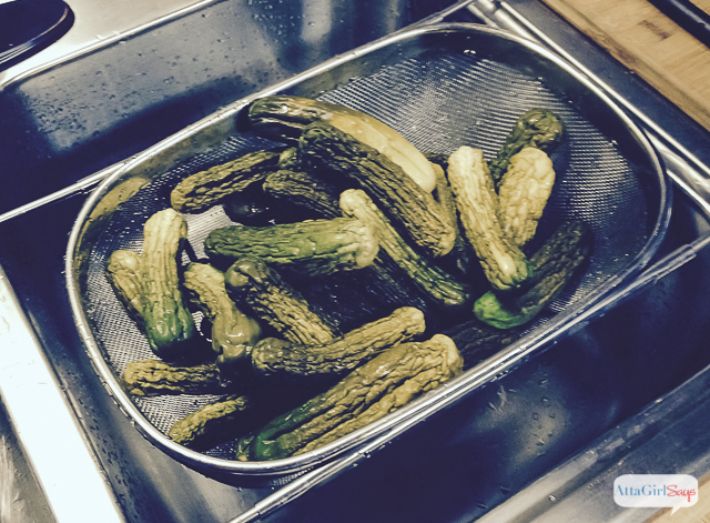 rinsing cucumbers after they have been brined to make pickles
