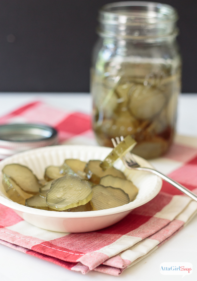 jar of sweet pickles with a bowl of sliced pickles