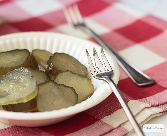 sweet pickle slices in an ironstone bowl with a pickle fork