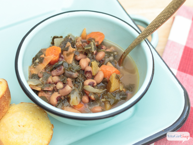 bowl ofhearty black eyed pea soup with collards, ham and root vegetables