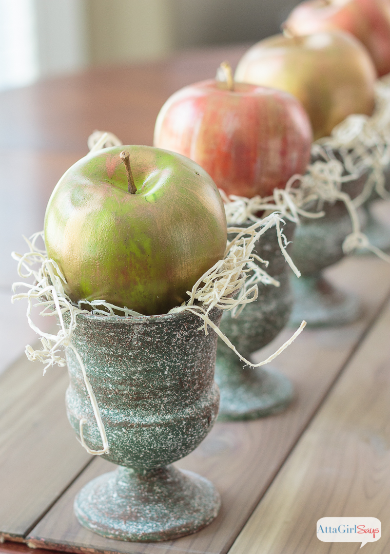 Add some sheen to your seasonal decor by making these metallic apples. Use creamy metallic waxes to transform faux fruit from the dollar store into pretty fall décor.
