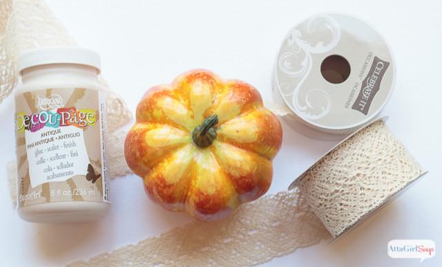 Use crochet lace ribbon and decoupage glue to transform inexpensive foam pumpkins into stunning seasonal decor for fall.