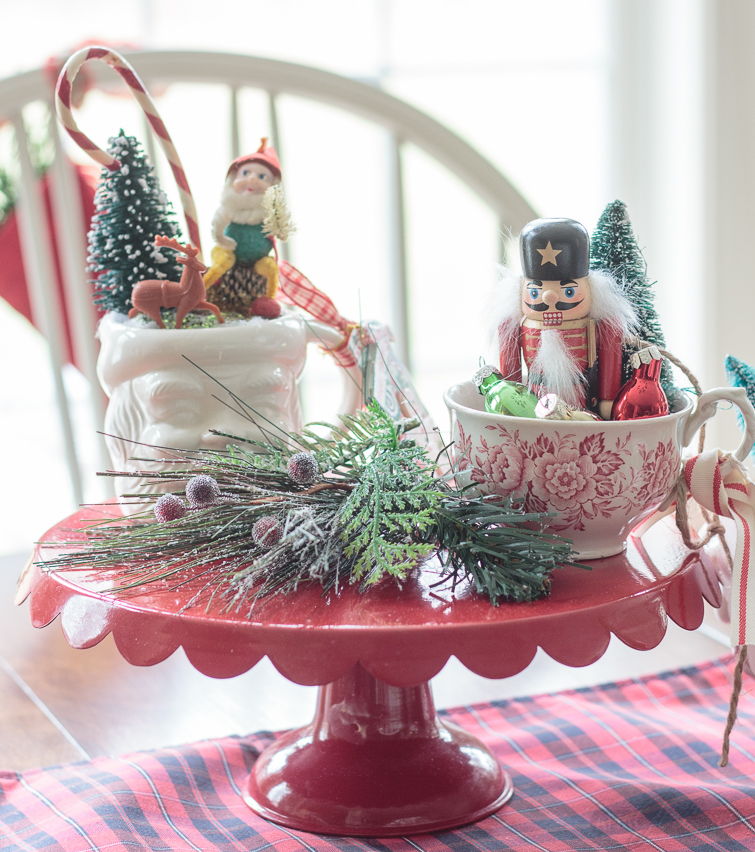 vintage Christmas mugs filled with vintage ornaments