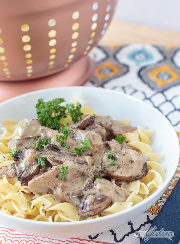 For those days when you're craving comfort food without the calories, try this easy light slow cooker beef stroganoff. It has the rich flavor of the classic dish without the extra fat and calories. This is still stick-to-your-ribs comfort food for cold winter days. Just 11 Weight Watchers points per serving, including 1 cup of egg noodles. Skip the noodles, and it's just 5 points per serving. #ad #worldmarkettribe #weightwatchers #slowcooker #beefstroganoff
