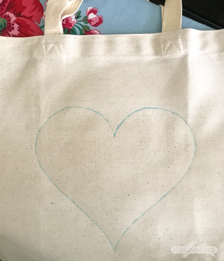 Don't throw away your ribbon scraps. Use the pieces to make this cute tote bag with a DIY heart decal. Perfect for those trips to the flower market or as goodie bags for a Galentine's Day party! #ribboncrafts #valentinesday #galentinesday #nosewproject #totebag