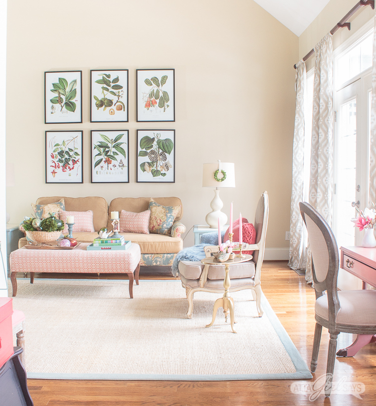 bright living room decorated with pastels and oversized botanical prints