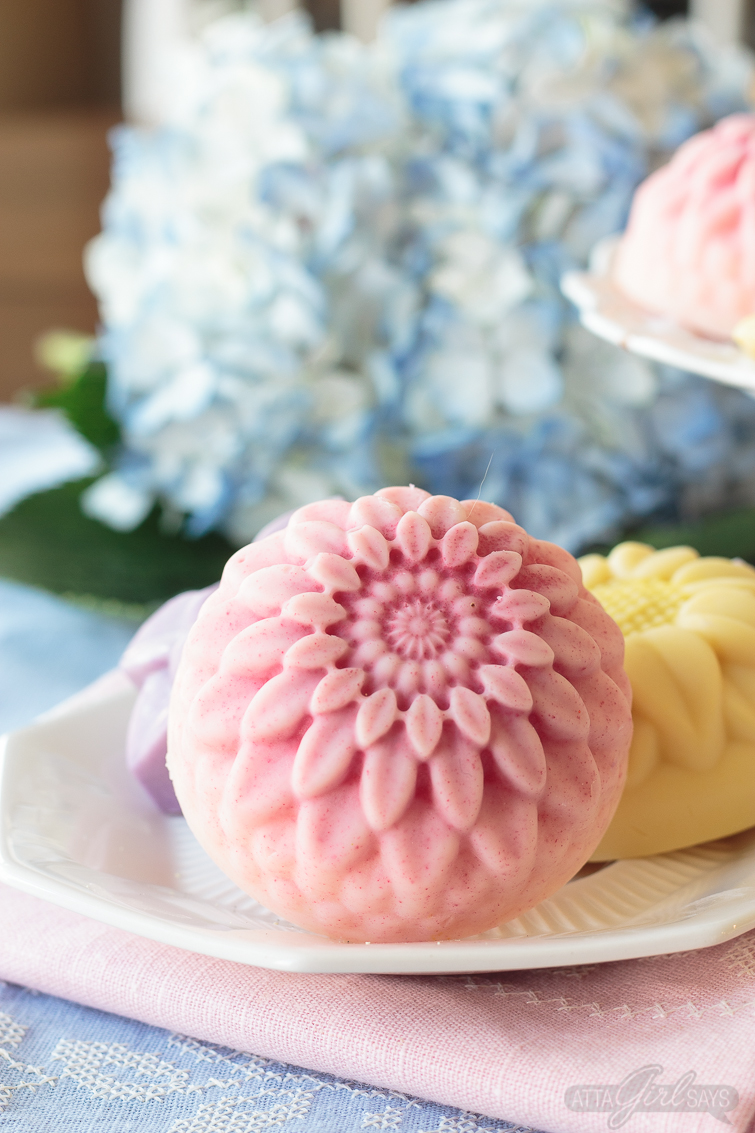 floral lotion bars with hydrangeas in the background