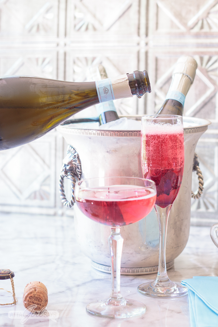 Pouring Prosecco into a champagne flute to make a blooming hibiscus cocktail. No special occasion necessary. Invite your best gal pals over for brunch and laughs and serve up these delicious pretty pink cocktails featuring La Marca Prosecco. Learn how to make infused hibiscus vodka and hibiscus simple syrup to make recipes to make three different versions of the hibiscus Prosecco cocktail, plus ideas for throwing a fabulous brunch. #ad #CelebratorySips #CelebrateWithLaMarca