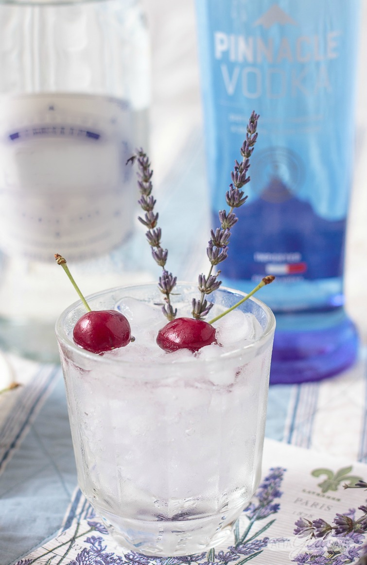 French Vodka lemonade cocktail with cherry and lavender garnish