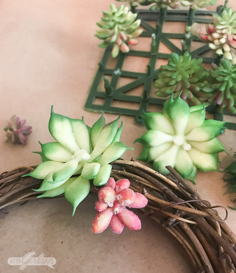 Learn how to make a realistic looking DIY faux succulent wreath for your summer decorating. Hang them on the backs of your dining chairs, on lampshades, on cabinet doors or anywhere else you like. They're great for summer and add a nice natural touch to your home decor. #succulents #succulentwreath #tablescape #decoratingideas #decoratingwithplants