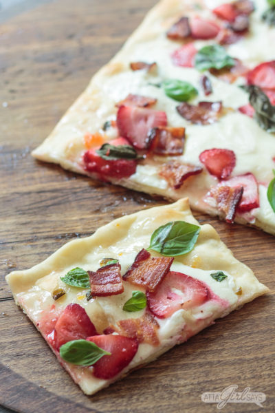 strawberry bacon flatbread pizza on a wooden pizza peel